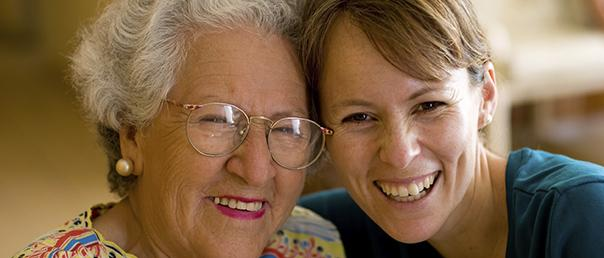 Trusted Caregivers for Over 40 Years - Caregiver With Her Patient