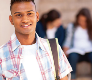 photo of young student with backpack and plaid shirt